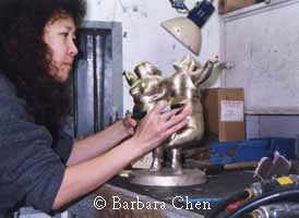 Chen inspects bronze casting